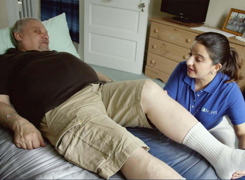 MJHS nurse helping with rehab with an elderly man