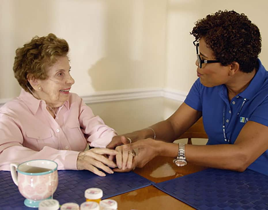 Nurse with an elderly woman at a table