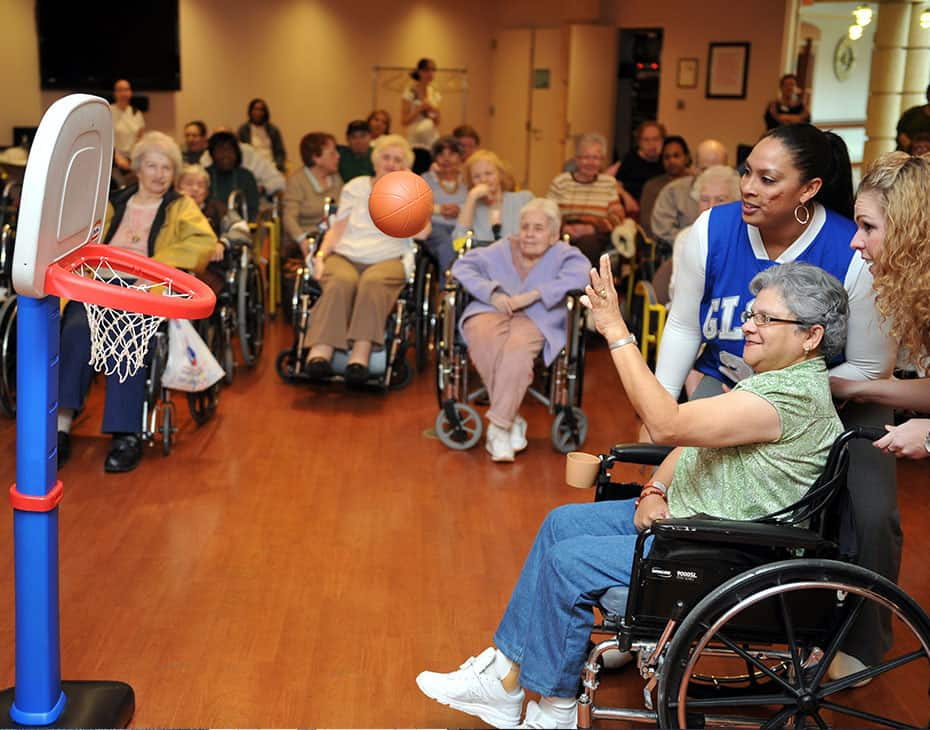 Senior Patients Gather Around a Game of Basketball