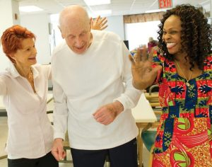 Two Women and an Elderly Man Looking Energetic