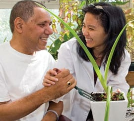 MJHS Caregiver Laughs Smiles and Assists Male Patient