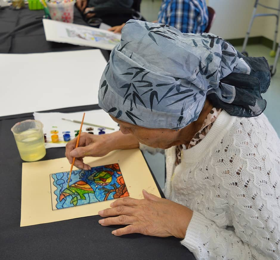 Elderly Woman Works on Watercolor Painting