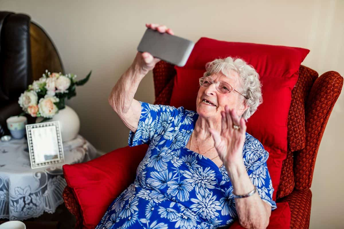 Senior Speaking to Caregiver on Video Call